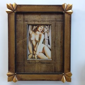 This closed corner frame (originally a piece of stretcher bar) was specially designed for the Art Deco image by Tamara de Lempicka. The mat board has been hand embossed, gilded and distressed by Irene Zapel of Framing Fabulous
